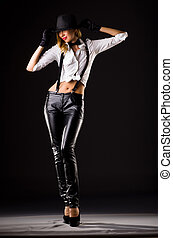 Pretty woman in leather pants isolated on white