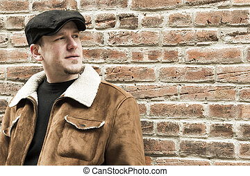 Cool Guy Brick Wall - Cool guy rocks an aviator jacket and...