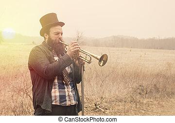 Gypsy Trumpet - Stylish bearded gypsy plays trumpet on a...