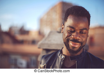 Good looking young black man in trendy clothes with negative spa