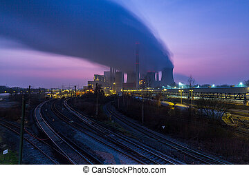 Coal-fired power plant at sunset - A coal power station at a...