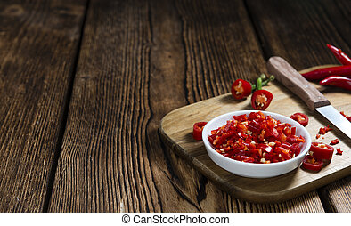Red Chilis cutted on vintage wooden background