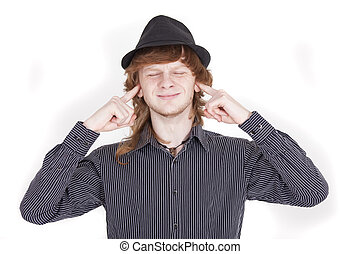 closing ears - man closing his ears with both fingers over...