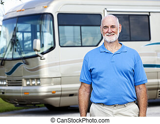 Senior Man with Motor Home - Handsome senior man standing in...