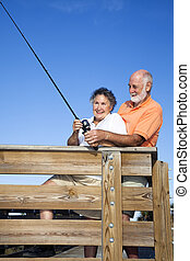 Senior Couple - Fishing Fun - Senior couple fishing together...