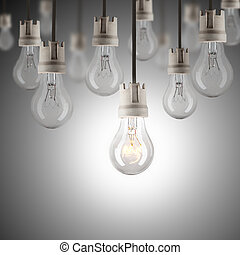 Light bulbs in row with single one shinning - hanging light...