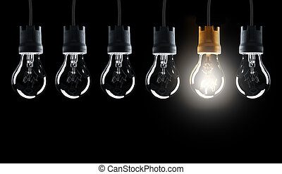 Light bulbs in row with single one shinning, isolated on...