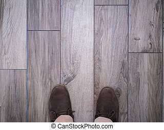 Feet on floor tiles faux wood - Walking on floor tiles with...