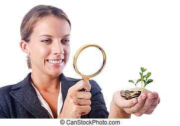 Business lady with magnifying glass isolated on white