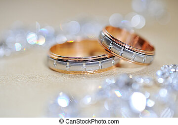 Gold wedding rings on table