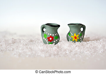 two miniature jug on background