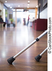 Crutches on floor in hospital clinic waiting room -...