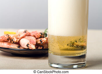 Beer still-life. - Glass of beer and plate with shrimps