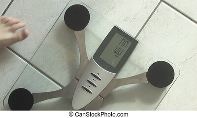 Boy, standing on weight scale