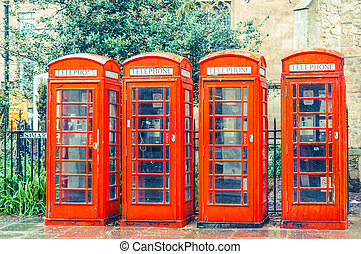 British red telephone boxes vintage filter applied - Row of...