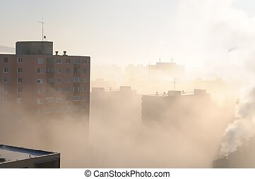 Residential area in fog and smog with chimney in background...