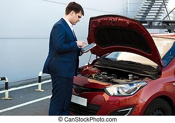 sales manager making photo under car bonnet - Portrait of...