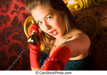 Young woman talking on phone Retro style