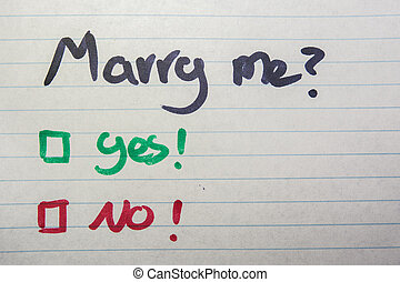 Do you marry me, yes or no written on piece of paper
