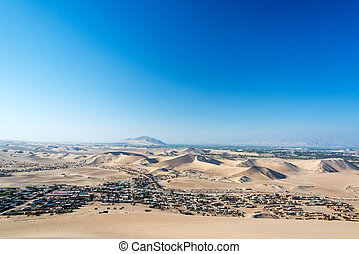 Desert Slums - Slums of the city of Ica, Peru in a dry arid...