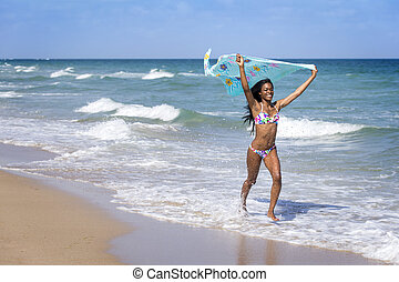 Young woman walking on the beach - Young woman at the beach...