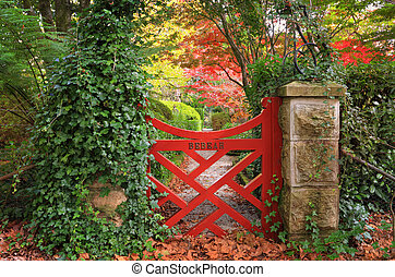 The little red gate at Bebeah Gardens in Autumn. The...