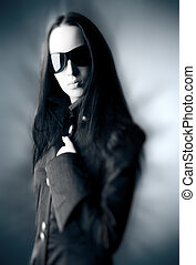 Goth woman with sunglasses Selective focus effect