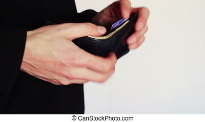 Man counting money in his wallet. - Man takes out a black...