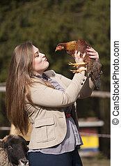 pollo, mujer, joven, juego