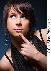Young woman pensive portrait