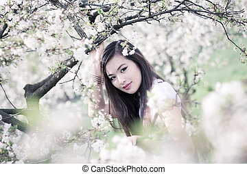 Young woman portrait - Young woman with cherry flowers...