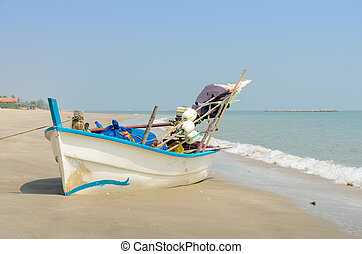 Wooden fishing boat on beach