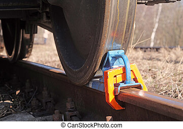Train shoe propped wheel train - Rusty and polished freight...