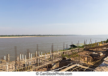 the pier beside Mekong river near the border between Thailand an