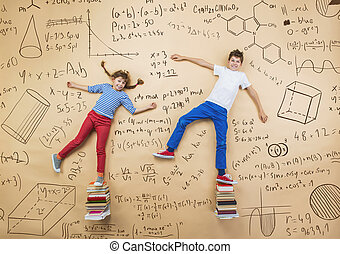 Two schoolkids learning - Cute boy and girl learning...