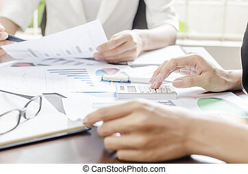 during a meeting - women working during a business meeting