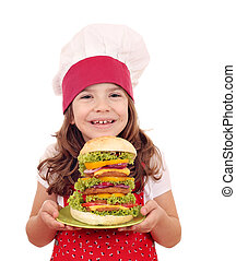 happy little girl cook with hamburger
