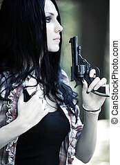 Woman with gun portrait Shallow dof