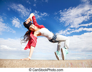beautiful dancing girl in movement - sport, dancing and...