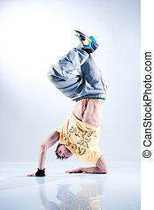Young man modern dance On soft white and blue background