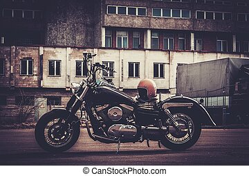 Custom made bobber motorcycle on a road - Custom made bobber...