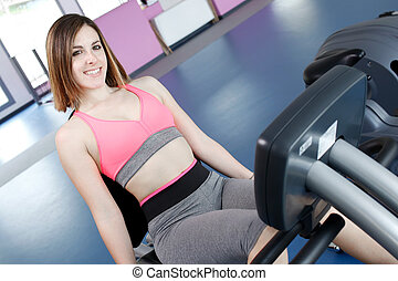 young girl doing legs exercise at gym. - young girl doing...