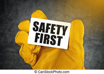 Safety First on Business Card, Male Hand in Yellow Leather...