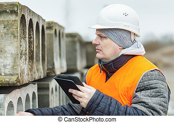 Civil engineer with tablet PC near