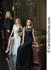 luxury girls in evening dresses in beautiful settings - chic...