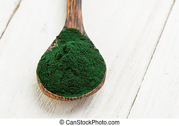 Spirulina powder - Organic spirulina algae powder in wooden...