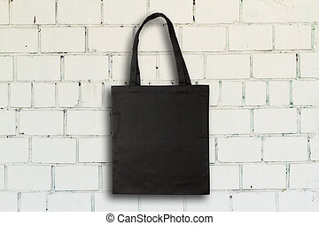 Fabric bag - Black fabric bag against vintage brick wall