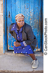 Drunken woman - Homeless drunk African woman with one eye...