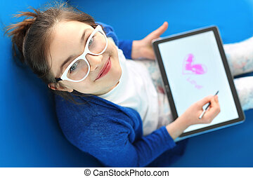 I love you ... - The girl, a teenager draws on a digital...