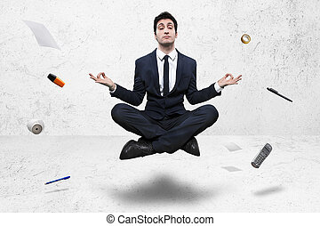 businessman meditating in yoga lotus pose on background -...